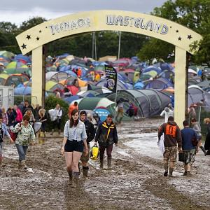 Revellers had to wade through a muddy campsite at the Isle of Wight festival last year