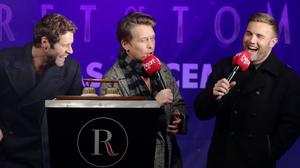 Howard Donald, Mark Owen and Gary Barlow of Take That switch on the Regent Street Christmas lights