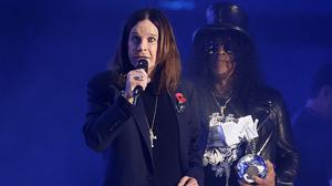 Ozzy Osbourne collects the Global Icon award from Slash at the MTV EMAs