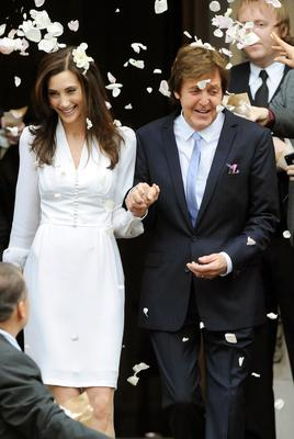 Sir Paul was all smiles again in 2011 as he married his third wife, American businesswoman Nancy Shevell. They tied the knot at Marylebone Town Hall, where Sir Paul walked down the aisle with his first wife, Linda (John Stillwell/PA)