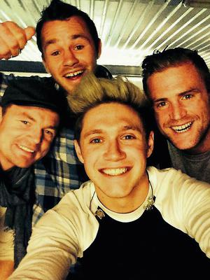 Niall with rugby stars Brian O'Driscoll, Jamie Heaslip and Cian Healy.