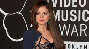 Selena Gomez clarified her relationship status after she was spotted at the same restaurant as an ex-boyfriend (Doug Peters/PA)