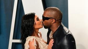Kanye West has congratulated wife Kim Kardashian on 'becoming a billionaire' after it was announced she was selling a stake in her beauty brand for 200 million dollars (about £162 million) (Ian West/PA)