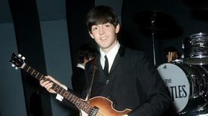 Paul McCartney pictured during Beatles rehearsals in Liverpool in 1963 - he is stepping up his bid to reclaim ownership of songs he wrote with John Lennon