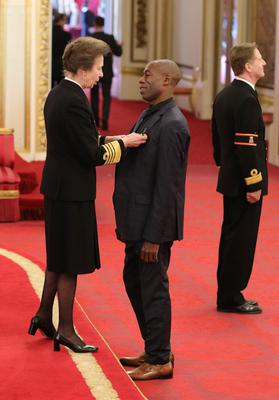 Andrew Roachford is made an MBE by the Princess Royal (Jonathan Brady/PA)