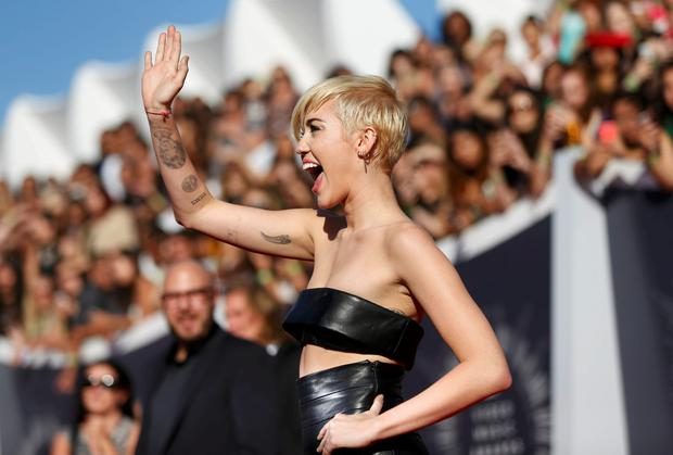 Miley Cyrus arrives at the 2014 MTV Video Music Awards in Inglewood, California