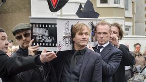 The Visage-decorated coffin of Steve Strange is taken from the hearse by members of Spandau Ballet, including Gary Kemp and Steve Norman, front right, and Boy George