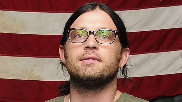 Nathan Followill's broken ribs have put Kings of Leon out of action (AP)