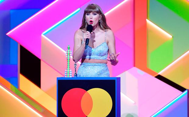 Taylor Swift accepts the Global Icon award during the Brit Awards 2021 at the O2 Arena, London