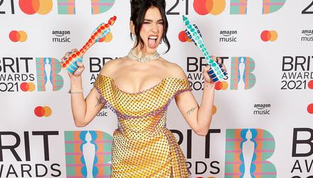Singer Dua Lipa poses with her awards at the BRIT Awards at the O2 Arena in London