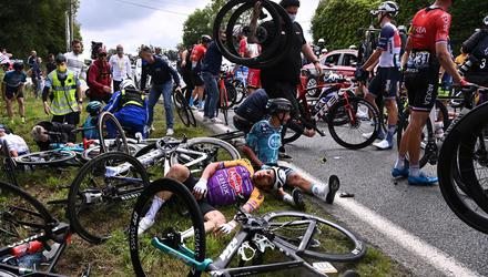Riders lie on the ground after crashing during the 1st stage of the 108th edition of the Tour de France cycling race on June 26, 2021. Picture by Anne-Christine Poujoulat/AFP via Getty