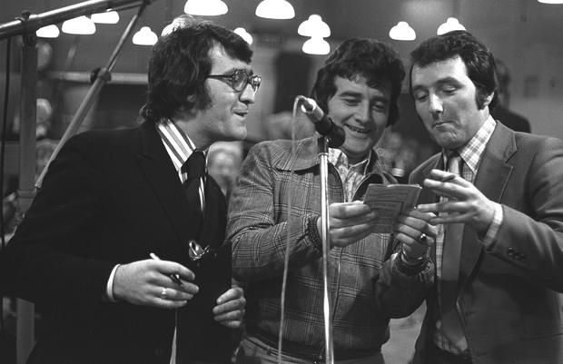 From left to right, RTE broadcasters Brendan Balfe, Larry Gogan and Mike Murphy during the recording of the radio quiz show 'Beat the Band' in March 1974.