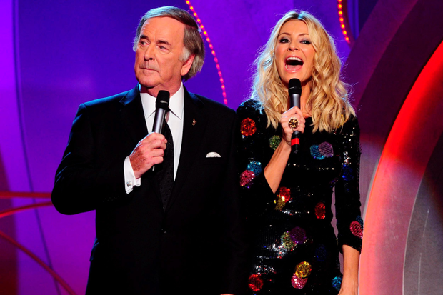Terry presenting the 'Children in Need' TV show with co-host Tess Daly. Photo: Ian West/PA