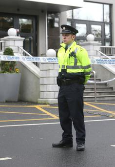 A Garda outside the Regency Hotel where a man was shoot dead. Photo: Damien Eagers.