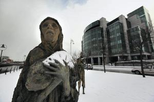 Memorial: The Famine memorial sculpture stands covered in snow outside The International Financial Services Centre in Dublin, Ireland.  Photo: Peter Macdiarmid/Getty Images