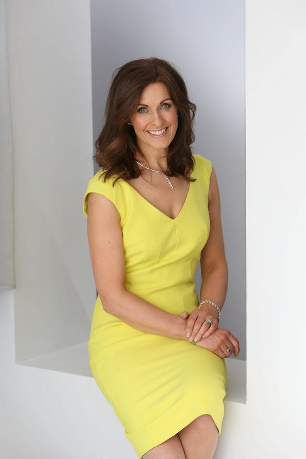 Alison Comyn pictured in Yellow Amanda Wakeley dress, €855. Photo: Fran Veale