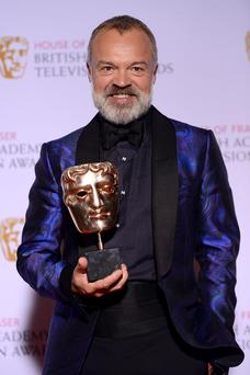Winning: Graham Norton with his BAFTA at the weekend