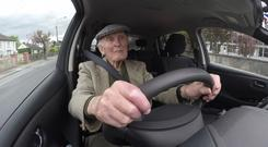 101 year-old John gets to grips with an electric car