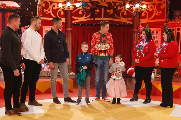 Real life hero: Tadhg Furlong, Sean O'Brien, Rob Kearney, Scott and Grace Lowe, along with their mums Bernie and Arlene Lowe, and Ryan Tubridy on the Late Late Toy Show last night. Photos: Andres Poveda