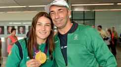 True champ .... Katie shows off her Olympic gold medal with dad Pete
