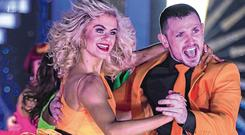 In step: Former 'Love/Hate' actor Johnny Ward and dance partner Emily Barker in action on 'Dancing With the Stars'