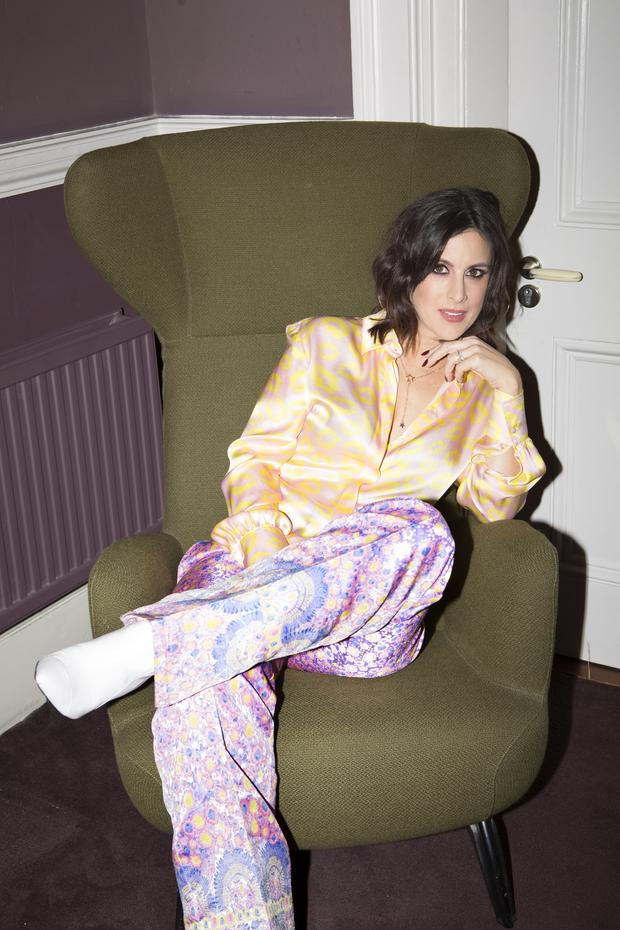 Lucy wears: Silk shirt, €310, Luisa Cerano, Arnotts; printed trousers, €350, made to order, Caitriona Hanley, catrionahanly.com; boots, €80, River Island; star pendant, €16, Betty & Biddy. Photo: Naomi Gaffey
