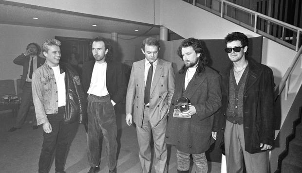 Paul McGuinness (centre) with U2 in 1986