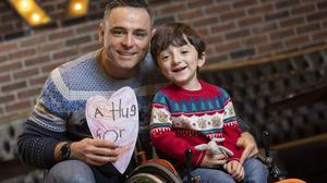 Adam King, with his dad David, was a big hit on The Late Late Toy Show and is back to meet his hero Hadfield. Photo: Fergal Phillips