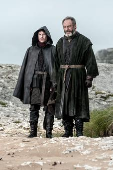 Joe Dempsie as Gendry; Liam Cunningham as Davos Seaworth in Game of Thrones.