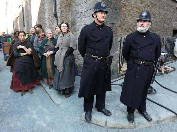 Actors wait to film Penny Dreadful on Bellevue Street next to the Guinness factory in Dublin