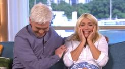 This Morning's Holly Willoughby fends off a bird in the studio (ITV grab)