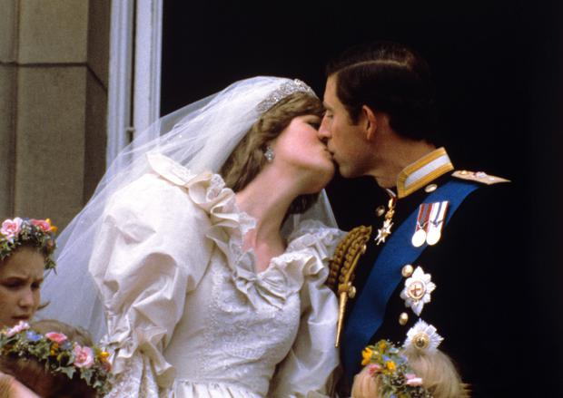 The Prince and Princess of Wales kissing on the balcony of Buckingham Palace after their wedding (PA)