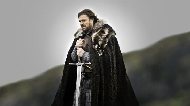 Ned Stark (Sean Bean) with his sword made by Tommy Dunne