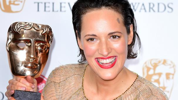Phoebe Waller-Bridge clutching her Bafta (Ian West/PA)