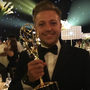 Simon Wilson with an Emmy