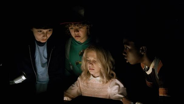 Eleven and the boys on Stranger Things