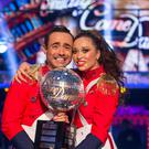 Joe McFadden and Katya Jones with the Strictly Glitter Ball (Guy Levy/BBC/PA)