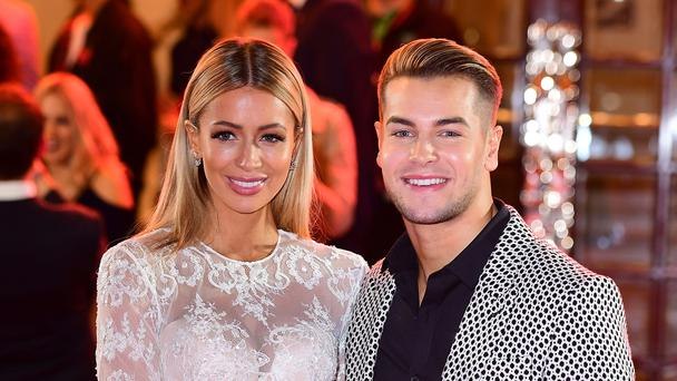 Love Island's Chris Hughes is 'obsessed' and still in love with ex Olivia Attwood, he said (Ian West/PA)