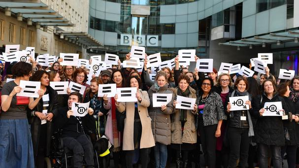 BBC employees gather outside Broadcasting House (John Stillwell/PA)