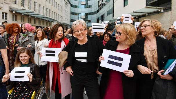 Journalist Carrie Gracie (centre) and BBC employees gather outside Broadcasting House (John Stillwell/PA)