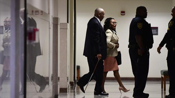 Bill Cosby, left, walks back to the courtroom (Correy Perrine/AP)