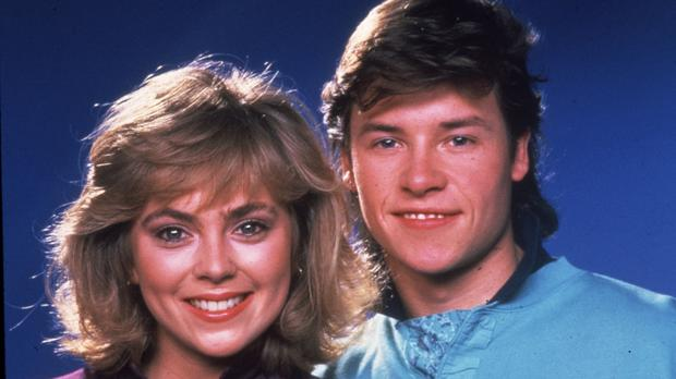 Annie Jones as Jane Harris and Guy Pearce as Mike Young in Neighbours in the 1980s (Rex)
