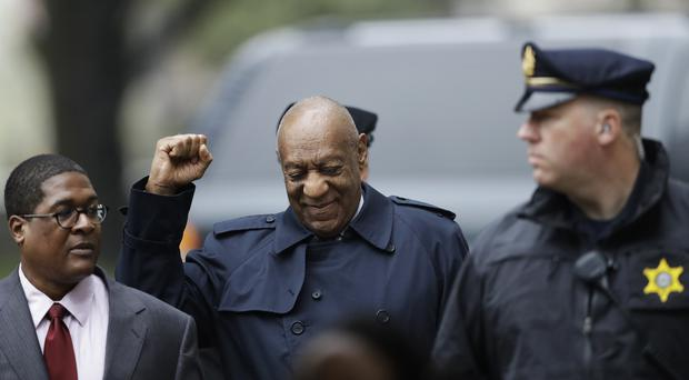 Bill Cosby gestures as he arrives for his sexual assault trial (Matt Slocum/AP)