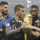 Members of the French football team celebrate winning the World Cup (left-right): Olivier Giroud, Lucas Hernandez, Thomas Lemar, Presnel Kimpembe and Florian Thauvin (Image: PA)