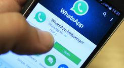 WhatsApp is used by three-quarters of Irish adults and has become the bedrock of community organisations, social and family groups. Photo: Jonathan Brady/PA