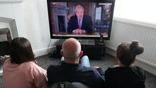 People watch Prime Minister Boris Johnson addressing the nation about coronavirus (PA)