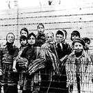 A picture taken just after the liberation by the Soviet army of Aufschwitz in January 1945 shows a group of children wearing concentration camp uniforms