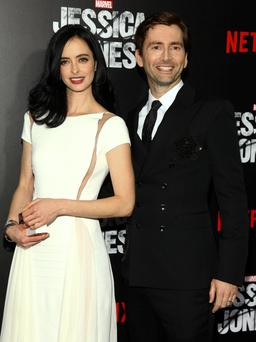 Krysten Ritter, left, and David Tennant, attend the Netflix original series premiere of Marvel's