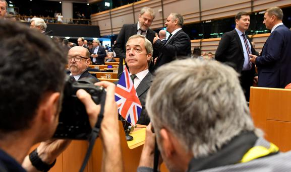 Gloating spectacle: Leader of Ukip, Nigel Farage, during a special session of European Parliament in Brussels on Tuesday