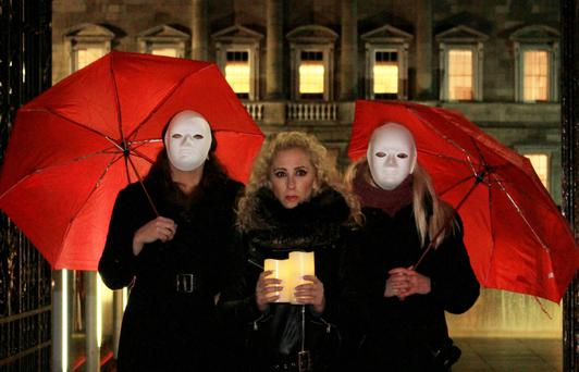 Protest: Kate McGrew (centre) is fervently against criminalising those who purchase sex